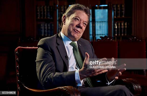 Colombian President Juan Manuel Santos speaks during an interview with AFP at Narino presidential palace in Bogota on April 18 2016 AFP PHOTO /...