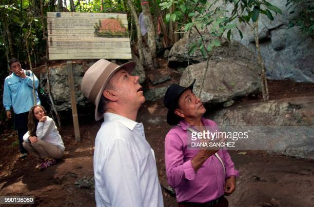 Colombian President Juan Manuel Santos stares at cave art before announcing the expansion by 15 million hectares of the Chiribiquete National Park...
