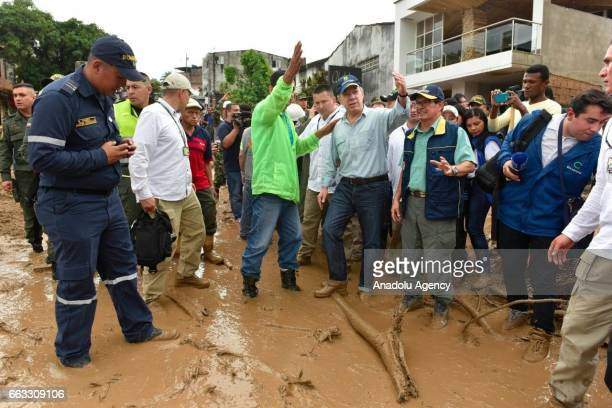 Colombian President Juan Manuel Santos visits the disaster area of a deadly landslide that happened following heavy rains in Mocoa Putumayo Colombia...