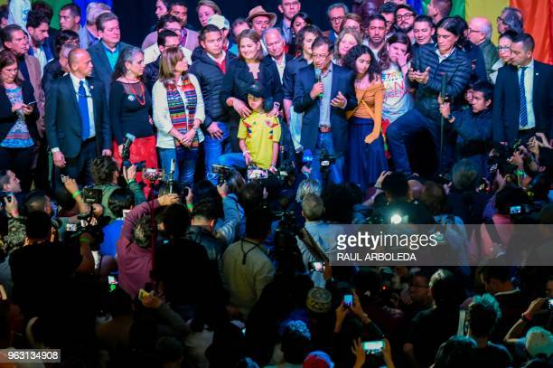 Colombian presidential candidate Gustavo Petro for the Colombia Humana Party addresses supporters in Bogota flanked by his running mate Angela...