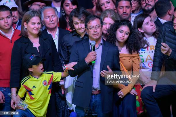 Colombian presidential candidate Gustavo Petro for the Colombia Humana Party addresses supporters in Bogota next to his wife Veronica Alcocer and...