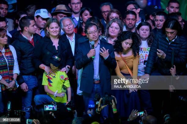 Colombian presidential candidate Gustavo Petro for the Colombia Humana Party addresses supporters in Bogota next to his wife Veronica Alcocer after...