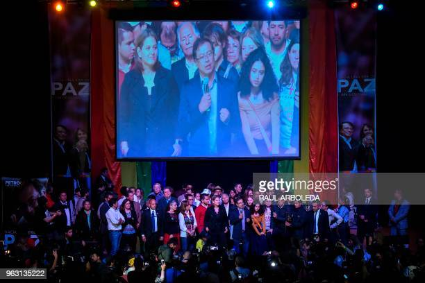 Colombian presidential candidate Gustavo Petro for the Colombia Humana Party addresses supporters in Bogota flanked by his wife Veronica Alcocer and...