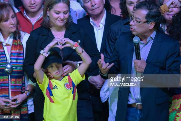Colombian presidential candidate Gustavo Petro for the Colombia Humana Party addresses supporters in Bogota next to his wife Veronica Alcocer and one...