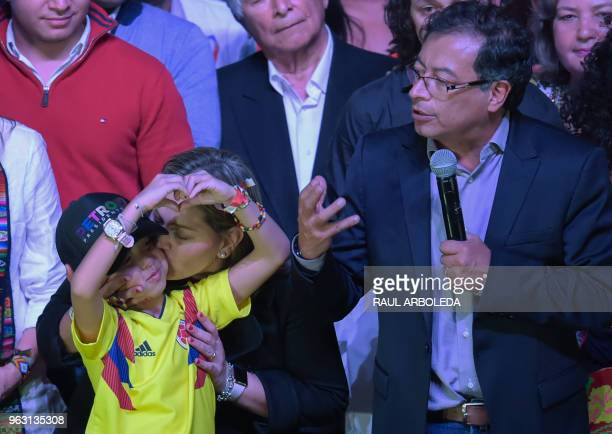Colombian presidential candidate Gustavo Petro for the Colombia Humana Party addresses supporters in Bogota as his wife Veronica Alcocer kisses one...