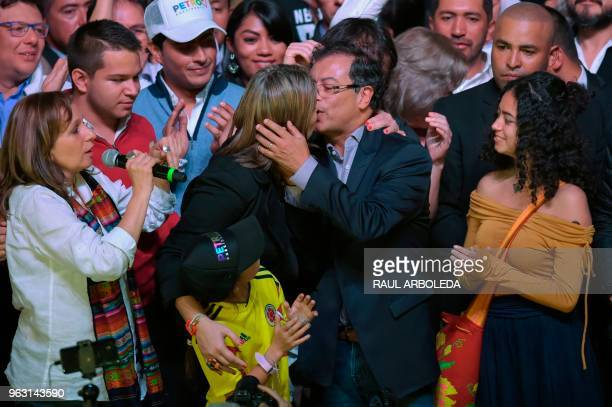 Colombian presidential candidate Gustavo Petro for the Colombia Humana Party kisses his wife Veronica Alcocer as they celebrate in Bogota after...