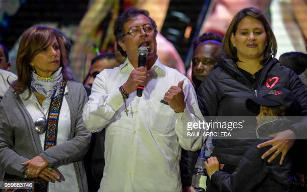 Colombian presidential candidate Gustavo Petro from Colombia Humana party speaks to supporters next to his wife Veronica Alcocer Garcia during a...