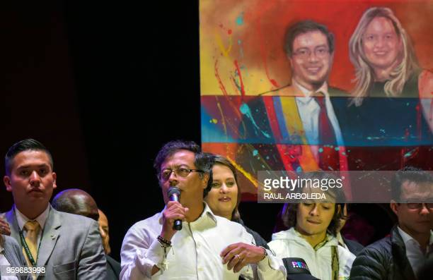 Colombian presidential candidate Gustavo Petro from Colombia Humana party speaks to supporters next to his wife Veronica Alcocer Garcia backdropped...