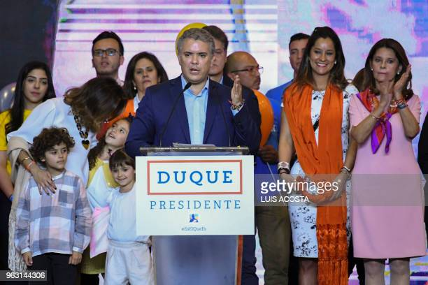Colombian presidential candidate Ivan Duque for the Democratic Centre party addresses supporters in Bogota next to his wife Maria Juliana Ruiz and...
