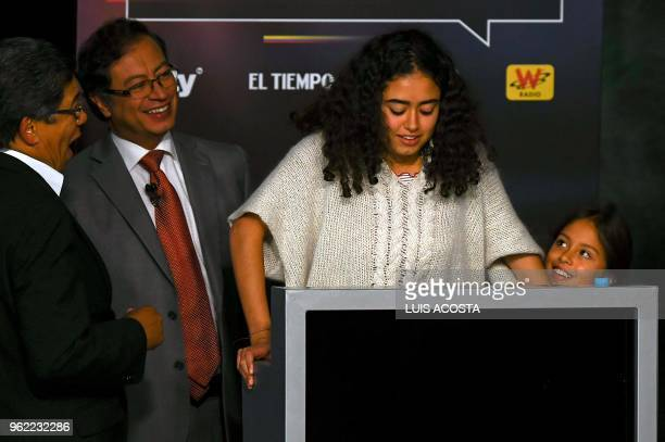 Colombian presidential Gustavo Petro for the Colombia Humana Party, jokes whit his daugthers Sofia and Antonella during a TV debate in Bogota on May...