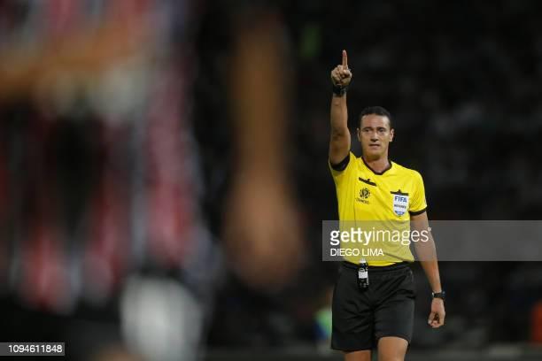 Colombian referee Wilmar Roldan gestures during the Copa Libertadores football match between Argentina's Talleres de Cordoba and Brazil's Sao Paulo...