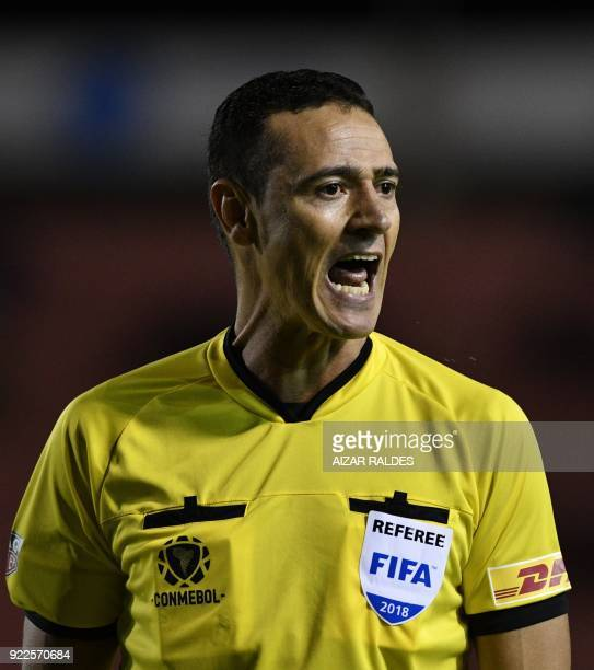Colombian referee Wilmar Roldan gestures during the Copa Libertadores football match between Bolivia's Wilsterman and Vasco Da Gama of Brazil at...