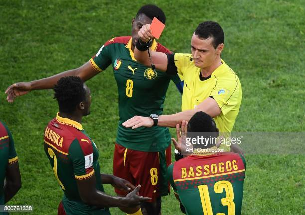Colombian referee Wilmar Roldan gives a red card to Cameroon's defender Ernest Mabouka during the 2017 FIFA Confederations Cup group B football match...