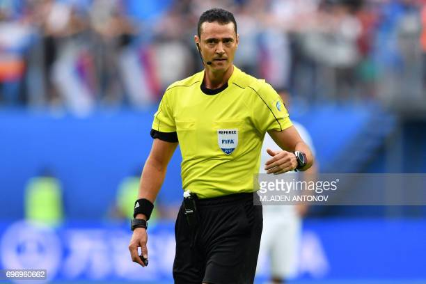 Colombian referee Wilmar Roldan officiates the 2017 Confederations Cup group A football match between Russia and New Zealand at the Krestovsky...