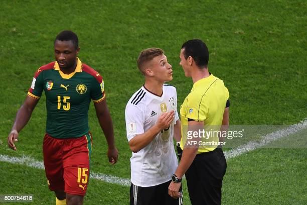 TOPSHOT Colombian referee Wilmar Roldan speaks to Germany's defender Joshua Kimmich next to Cameroon's midfielder Sebastien Siani during the 2017...
