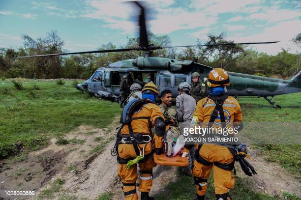 A Colombian rescue crew evacuates a victim in a Brazilian Air Force helicopter as part of an earthquake simulation exercise held by Air Force troops...