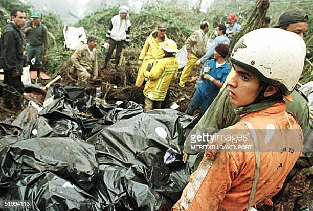 Colombian rescue worker takes a break 22 December after collecting body bags at the site of the American Airlines plane crash on Mount San Jose near...