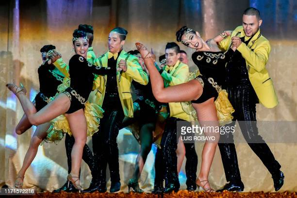 Colombian salsa dancers of Danza Viva group participate in the groups salsa cabaret professional category during the 14th World Salsa Festival in...