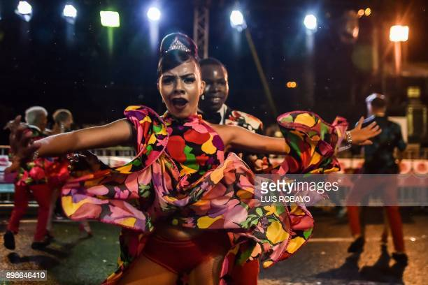 Colombian salsa dancers perform during the Salsodromo parade during the opening of the 60th Cali Fair in Cali on December 25 2017 More than 1500...