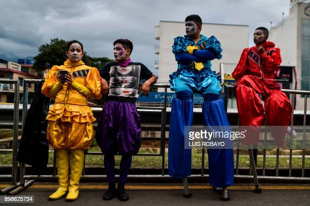 TOPSHOT Colombian salsa dancers wait backstage prior to the Salsodromo parade in Cali Colombia on December 25 opening the 60th Cali Fair More than...