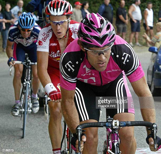 Colombian Santiago Botero rides in front of Frenchman Sylvain Chavanel during a breakaway in the 15th stage of the 90th Tour de France cycling race...