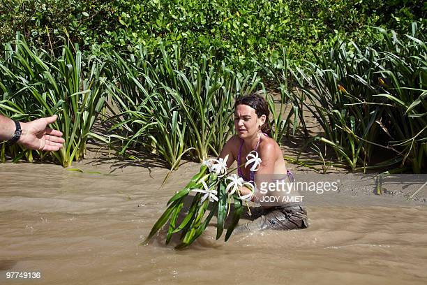 Colombian scientist Ariadna Libertad Burgos of the National Museum of Natural History takes samples to study the biodiversity of the mangrove on...