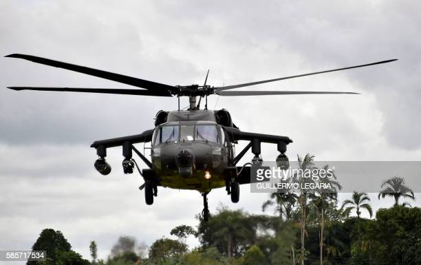 A Colombian Sikorsky AH60L Arpía IV attack helicopter takes off at the airbase in San Jose del Guaviare to participate in an operation to destroy a...