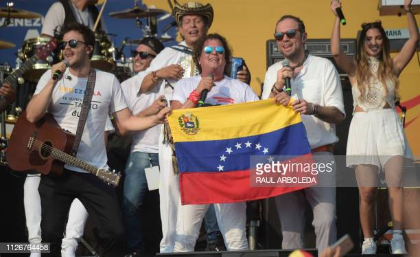 Colombian singer Carlos Vives and other artists perform during the Venezuela Aid Live concert organized to raise money for the Venezuelan relief...