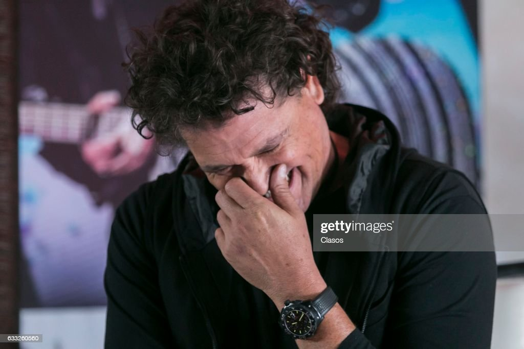 Colombian singer Carlos Vives laughs during a press conference after reaching the gold and triple platinum disc with his album 'La Bicicleta' at Presidente Intercontinental Hotel on January 31, 2017 in Mexico City, Mexico.