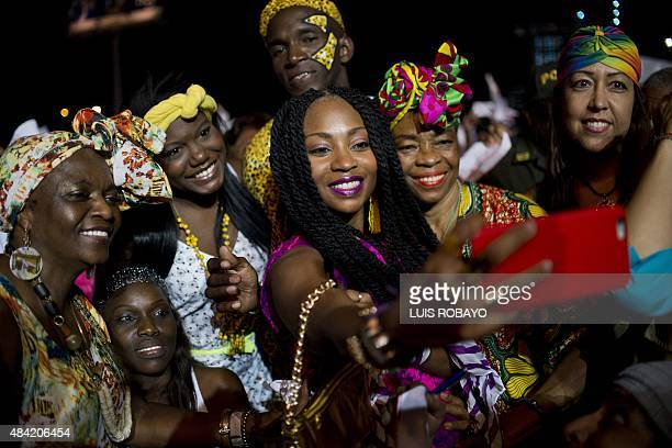 Colombian singer Gloria 'Goyo' Martinez a member of the AfroColombian band Chocquibtown takes a 'selfie' with others during the 19th Pacific Music...