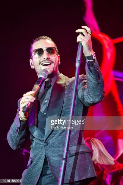 Colombian singer Juan Luis Londono Arias aka Maluma performs live on stage during a concert at the MercedesBenz Arena on October 3 2018 in Berlin...
