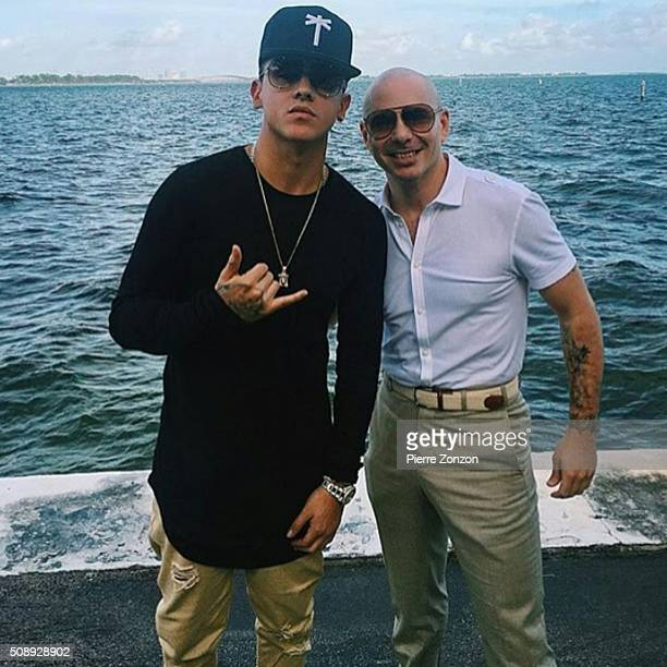 Colombian Singer Kevin Roldan poses Mr 305 Pitbul at the Palmeiras Beach Club on February 5 2016 in Coconut Grove Miami Florida