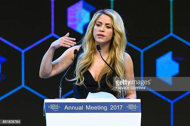 Colombian singer Shakira delivers a speech after receiving the Crystal Award during the Crystal Award ceremony on the eve of the opening day of the...