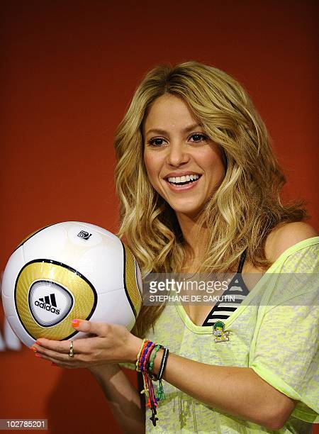 Colombian singer Shakira holds the Jo'bulani football that will be used for the final during a press conference on July 10 2010 at Soccer City...