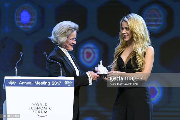 Colombian singer Shakira receives the Crystal Award from Chairperson of the Schwab Foundation Hilde Schwab during the Crystal Award ceremony on the...