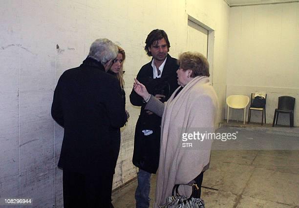 Colombian singer Shakira talks with her parents William Mebarak and Nidia Ripoli next to her producer and ex boy friend Antonio De la Rua, on January...