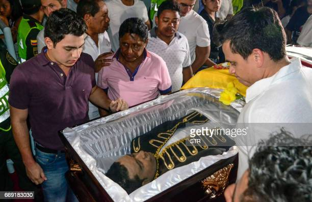 Colombian singer Sivestre Dangon a friend of Colombian singer Martin Elias cries over the coffin during his friend's funeral in Valledupar northern...
