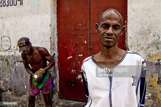 Colombian slum dweller stands in front of a rented house in the ghetto of Calvario on 5 April 2004 in Cali Colombia Calvario a slum right in the...