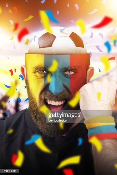 Colombian soccer fan with football inside the head