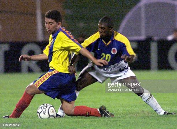Colombian soccer player Felipe Chara fights for the ball with Ecuadoran Mejia Lider 28 January 2001 in Portoviejo Ecuador El jugador colombiano...