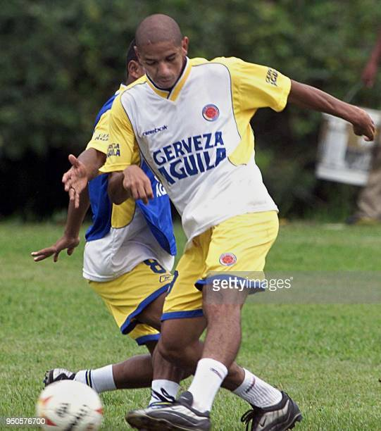 Colombian soccer players Fredy Grisales and David Ferreira fight for the ball during a practice session in Armenia Colombia 28 July 2001 Colombia is...