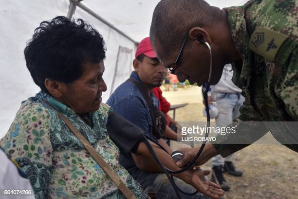 A Colombian soldier doctor attends wounded people at a shelter in Mocoa Putumayo department southern Colombia on April 3 2017 Residents of Mocoa were...