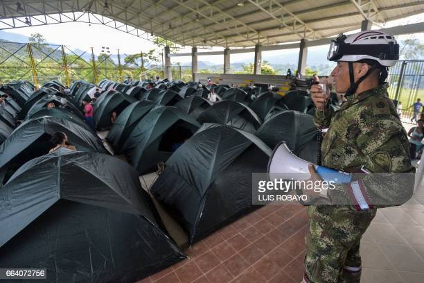 A Colombian soldier gives instructions to victims at a shelter in Mocoa Putumayo department southern Colombia on April 3 2017 Residents of Mocoa were...
