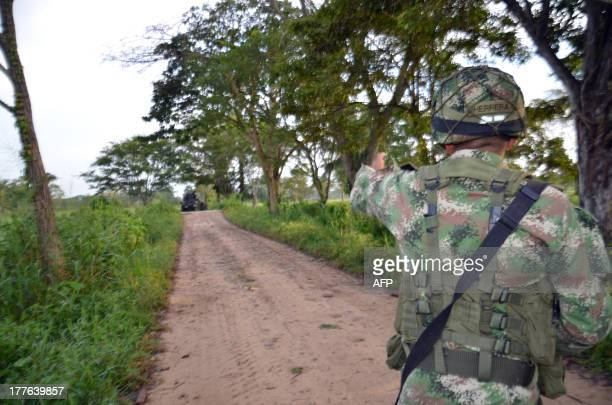 Colombian soldier stands guard in the town of Tame, Arauca department, on August 25, 3013 close to the area where Revolutionary Armed Forces of...