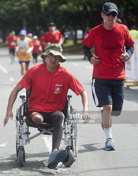 A Colombian soldier victim of a landmine waits for the start of the 'Lend Your Leg 11K Run Against Mines' event held in the framework of the...
