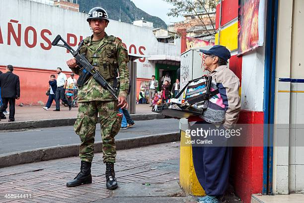 Soldier and small businessperson in Bogota, Colombia