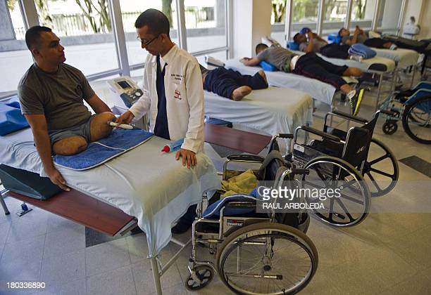 Colombian soldier William Loaiza victim of a landmine five months ago attends his rehabilitation therapy session at the Heroes de Paramillo hospital...