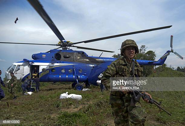 Colombian soldiers arrive to an area of coca plantations to take part in a joint operation with peasants to eradicated coca plantations in the...