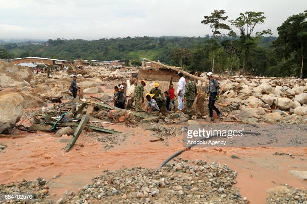 Colombian soldiers carry out search and rescue operation on the damaged site at Mocoa after the flood in Putumayo of Colombia on April 03 2017 At...