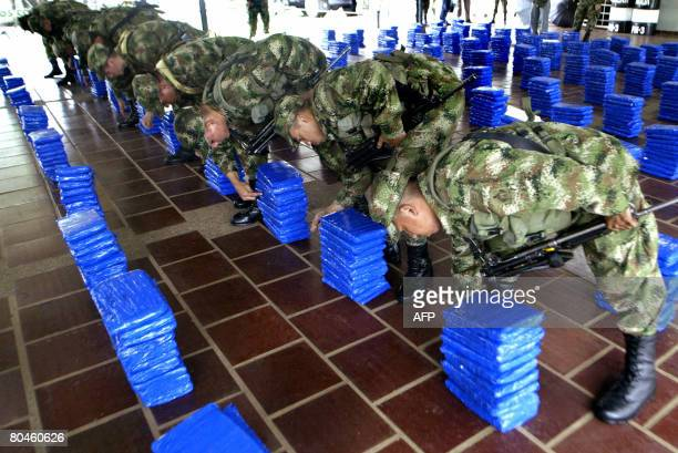 Colombian soldiers count packages containing marihuana during a press conference on April 1 in Cali department of Valle del Cauca Colombia The...